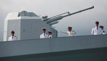 Chinese navy servicemen stand at the rea
